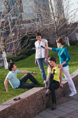 young group communication in park in summer photo