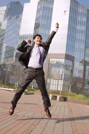 Jumping businessman photo