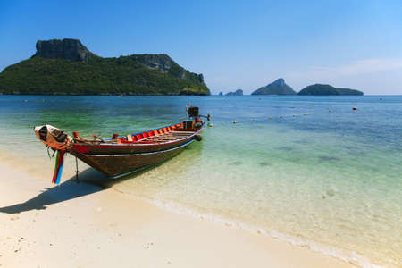 ashore: A boat in the sea of the Thailand.