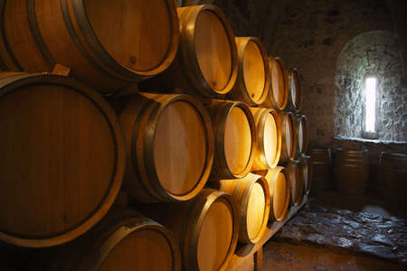 Wine barrels in a old wine cellar photo