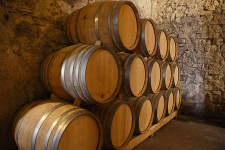 old container: Wine barrels in a old wine cellar