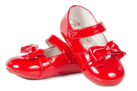 Female red shoes on white background photo
