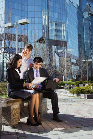 laptop stand: Business people meeting outdoor in front of office building