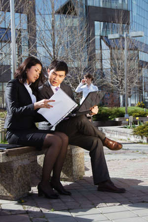 Business people meeting outdoor in front of office building photo