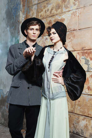Retro styled fashion portrait of a young couple. Clothing and make-up in 1920s style. photo