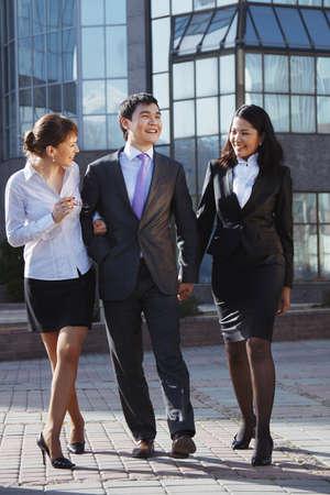 career fair: Business people walking and talking in the street.