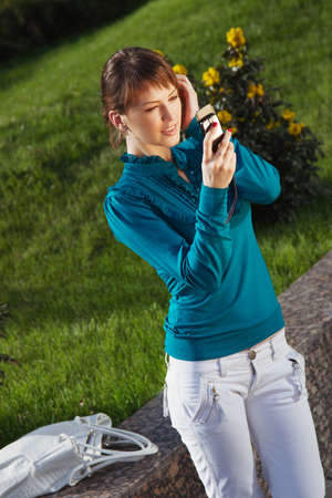 Woman posing for a photograph taken from his cell phone photo