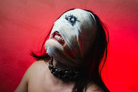 Horrible guy with scary mouth and one eye, extreme body-art photo