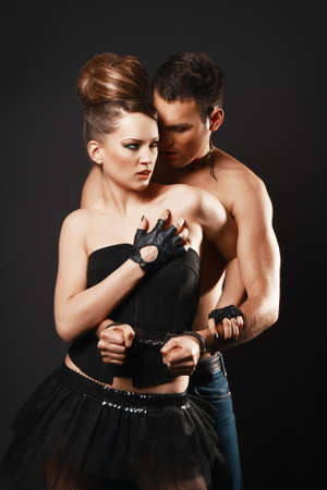sexy topless woman: Couple in love. Happy loving couple. Dark background. Stock Photo