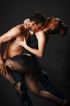 erotic couple: romantic tango dancing couple on black Stock Photo