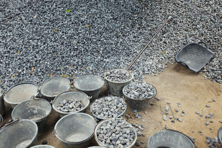 Pile of rocks for construction  Buckets for tranportation  photo