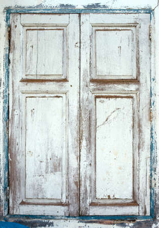 Wooden window shutters - Closed old shuttered weathered  Stock Photo