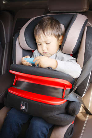 drive safely: Luxury baby car seat for safety with happy kids Stock Photo