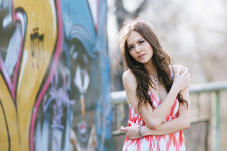 Beautiful young multicultural woman outdoors in a fashion pose  Selected focus