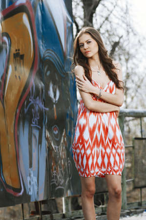 Beautiful young multicultural woman outdoors in a fashion pose  Selected focus  photo