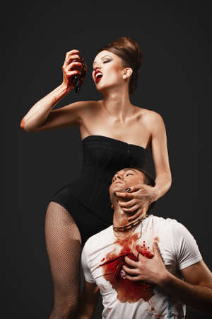 crazy man: Vampire woman eating man heart