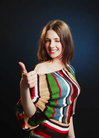 thumbsup: Young attractive female with thumbs-up and OK