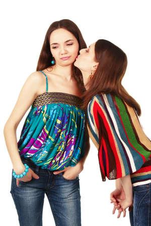 Beautiful women trying to make unpleasant kiss photo