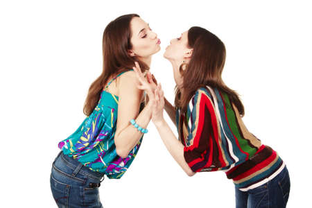 Two young attractive girls kissing - isolated on white photo
