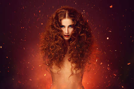 topless brunette: Fantasy fire lady. Red hair over fire sparkles.