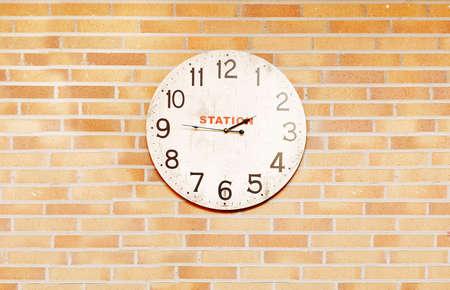 splotchy: An old station clock over bricks wall