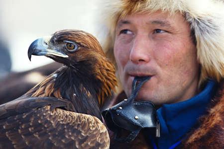 nomadism: Bird hunter with a golden eagle (Aquila chrysaetos). Kazakhstan. Editorial