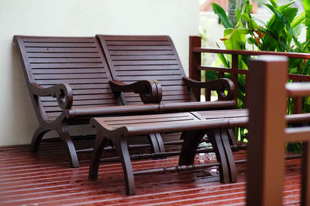 garden bench: Adirondack wooden chairs on a patio in the garden.