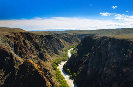 Beautiful river in Charyn canyon and blue sky with clouds in Kazakhstan photo