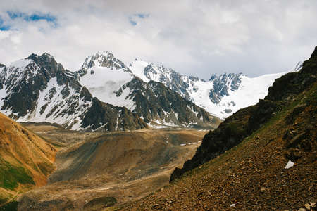 Beautiful Tien shan peaks and mountains near Almaty. Dramatic overcast sky. Beauty world. photo