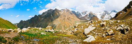 tien shan: Panorama view on Tien shan peaks and mountains near Almaty. Dramatic overcast sky. Beauty world.