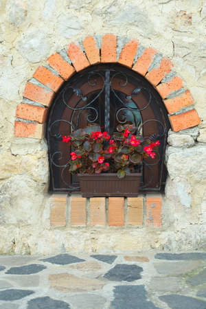 venice italy: Ornate window with flowers Stock Photo