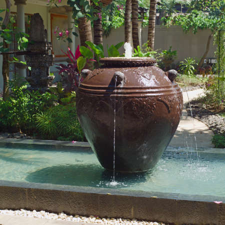 Fountain in backyard, gardening design Stock Photo