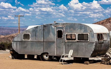 An old aluminum travel trailer in the Nevada desert