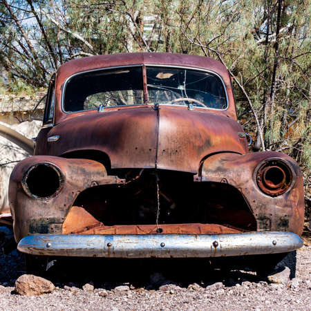 car grill: A rusty hulk of a car in the Nevada desert Stock Photo