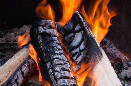 smolder: A campfire burns in a fire pit