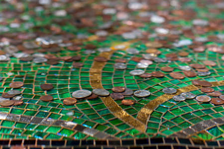 distort: Ripples of water distort and bend the images of coins in a fountain Stock Photo