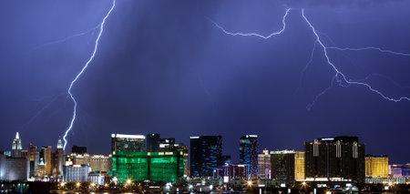 streak lightning: LAS VEGAS - JULY 27: Lightning from monsoonal storms streaks through the sky over the Las Vegas Strip on July 27, 2014. Editorial