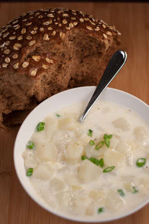 spud: Bowl of hot potato soup with dark bread Stock Photo