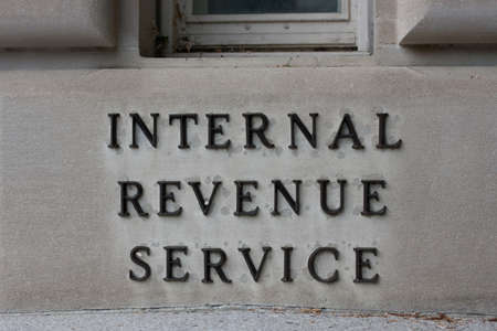 irs: IRS Headquarters Sign in Washington D.C.