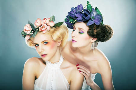 Two nymphs in colourful wreaths Stock Photo - 11761504