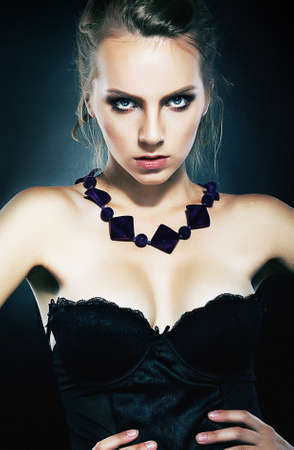 Beautiful girl supermodel with necklace posing in studio Stock Photo - 11865157