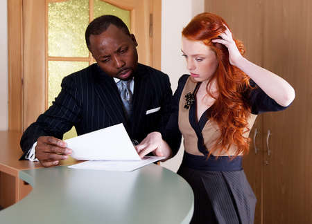 Two standing businesspeople coworkers talking Stock Photo - 11865127