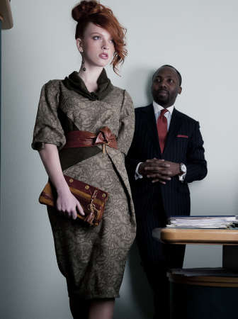 model nice:  Black american man looking at walking red haired woman