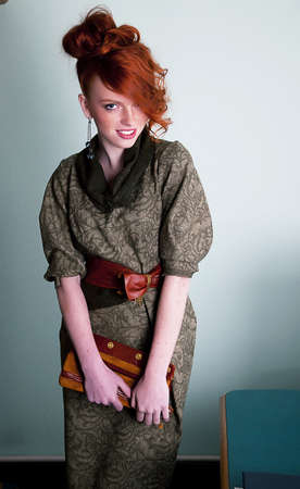 belle: Pretty young redhaired freckled woman fashion model