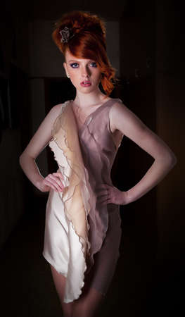 dishy: Red haired super model posing in fashion dress - series photos  Stock Photo