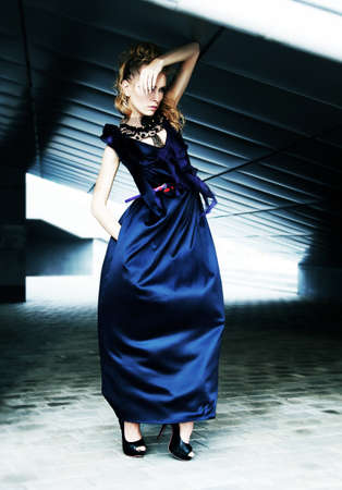 Blonde glamorous model in fashion dress over industrial background Stock Photo - 11928534