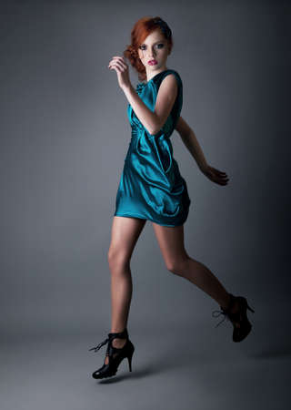 red haired girl: Healthy young active girl running in blue dress  Stock Photo