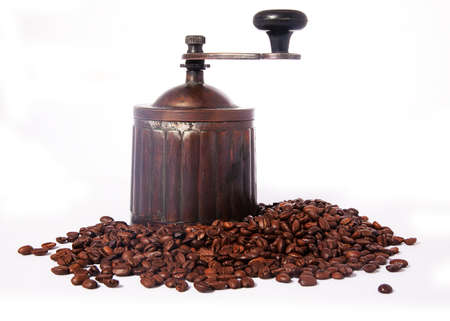 Old-fashioned coffee mill and heap of coffee beans  photo