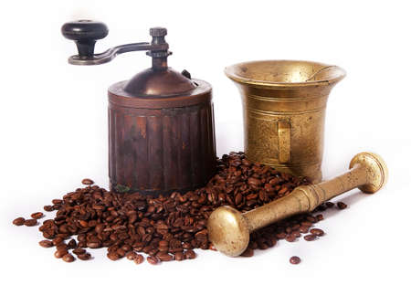 Ancient coffee grinder, mill and brass mortar  photo