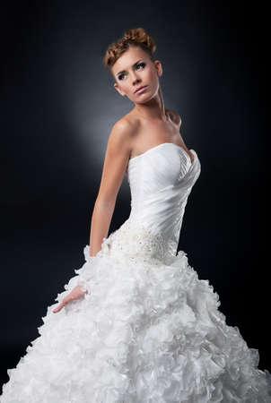 marital: Beautiful young bride in bridal dress posing in studio  Stock Photo